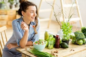 lady eating green vegetables